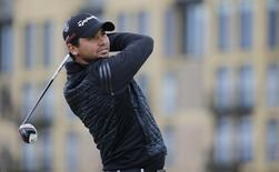 Jason Day of Australia watches his tee shot on the third hole during the third round of the British Open golf championship on the Old Course in St. Andrews, Scotland, July 19, 2015. REUTERS/Paul Childs