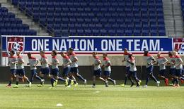 Members of the U.S. men's national soccer team run together during a team training session in Harrison, New Jersey, May 30, 2014. REUTERS/Mike Segar