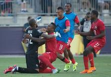 Jul 25, 2015; Chester, PA, USA; Panama goalkeeper Luis Mejia (12) celebrates with his team after a victory against the United States in the CONCACAF Gold Cup third place match at PPL Park. Mandatory Credit: Bill Streicher-USA TODAY Sports