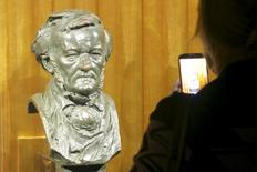 A visitor takes a picture of a bust of German composer Richard Wagner at the Richard Wagner Museum in Bayreuth, Germany, July 24, 2015. REUTERS/Michael Roddy