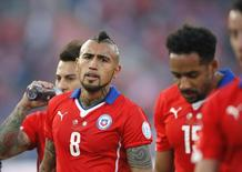 Chile's Arturo Vidal leaves the pitch with his teammates at halftime during their Copa America 2015 final soccer match against Argentina at the National Stadium in Santiago, Chile, July 4, 2015. REUTERS/Henry Romero