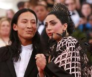 """U.S. singer Lady Gaga (R) is seen with American fashion designer Alexander Wang after arriving for the Metropolitan Museum of Art Costume Institute Gala 2015 celebrating the opening of """"China: Through the Looking Glass,"""" in Manhattan, New York May 4, 2015. REUTERS/Andrew Kelly"""