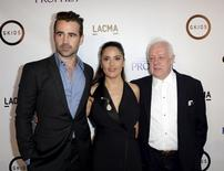 """Producer and cast member Salma Hayek-Pinault (C) poses with actor Colin Farrell (L) and director Jim Sheridan during the Los Angeles screening of Khalil Gibran's """"The Prophet"""" at Los Angeles County Museum of Art's Bing Theater in Los Angeles, California, July 29, 2015. REUTERS/Kevork Djansezian"""