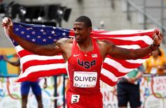 David Oliver of the United States reacts after winning the men's athletics 110m hurdles final during the 2015 Pan Am Games at CIBC Pan Am Athletics Stadium. Mandatory Credit: Rob Schumacher-USA TODAY Sports