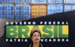 Brazil's President Dilma Rousseff delivers a speech during a ceremony at the Planalto Palace in Brasilia, Brazil, June 24, 2015. When she visits New York on Monday, President Dilma Rousseff will have a tough time convincing Wall Street her weakened government can pull Brazil out of a stall and save the once-booming nation's investment-grade credit rating. REUTERS/Bruno Domingos