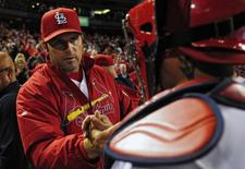 Sep 17, 2014; St. Louis, MO, USA; St. Louis Cardinals manager Mike Matheny (22) celebrates with catcher Yadier Molina (4) after defeating the Milwaukee Brewers at Busch Stadium. The Cardinals defeated the Brewers 2-0. Mandatory Credit: Jeff Curry-USA TODAY Sports