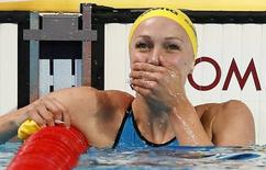 Sarah Sjostrom of Sweden reacts after setting a new world record in women's 100m butterfly final at the Aquatics World Championships in Kazan, Russia, August 3, 2015.     REUTERS/Stefan Wermuth  - RTX1MVEP