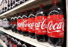 Bottles of Coca Cola are seen in a store display in New York February 9, 2010.  REUTERS/Lucas Jackson
