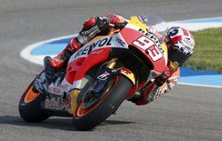 Honda MotoGP rider Marc Marquez of Spain rides through a turn during practice for the Indianapolis GP in Indianapolis August 8, 2015. REUTERS/Brent Smith