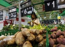 A woman chooses vegetables at a supermarket in Beijing, China, July 9, 2015. REUTERS/Kim Kyung-Hoon