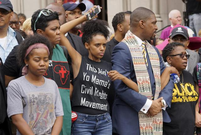 Protesters prepare to march in downtown St. Louis August 10, 2015. REUTERS/Rick Wilking