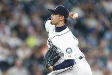 Aug 12, 2015; Seattle, WA, USA; Seattle Mariners pitcher Hisashi Iwakuma (18) throws the ball against the Baltimore Orioles during the eighth inning of his no-hit, 3-0 victory at Safeco Field. Joe Nicholson-USA TODAY Sports