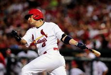 Aug 12, 2015; St. Louis, MO, USA; St. Louis Cardinals catcher Yadier Molina (4) hits a double off of Pittsburgh Pirates relief pitcher Joe Blanton (not pictured) during the eighth inning at Busch Stadium. Jeff Curry-USA TODAY Sports