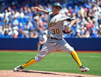 Aug 13, 2015; Toronto, Ontario, CAN;  Oakland Athletics starting pitcher Jesse Chavez (30) delivers a pitch against Toronto Blue Jays at Rogers Centre.   Dan Hamilton-USA TODAY Sports