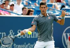 Novak Djokovic (SRB) returns a shot against Benoit Paire (not pictured) on day five during the Western and Southern Open tennis tournament at Linder Family Tennis Center. Mandatory Credit: Aaron Doster-USA TODAY Sports