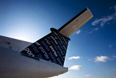 The tail of a Porter Airlines Bombardier Q400 turboprop aircraft is seen in Toronto, in this February 23, 2009 file photo.  REUTERS/Mark Blinch/Files