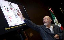 Eduardo Matos Moctezuma, an archaeologist from Mexico's National Institute of Anthropology and History (INAH) points to a drawing of the Templo Mayor Aztec complex, during a news conference at the Anthropology Museum in Mexico City August 20, 2015. REUTERS/Henry Romero