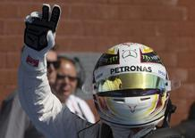 Mercedes Formula One driver Lewis Hamilton of Britain celebrates his pole position after the qualifying session at the Belgian F1 Grand Prix in Spa-Francorchamps, Belgium August 22, 2015. REUTERS/Yves Herman