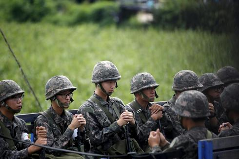 North, South Korea officials meet at DMZ in bid to ease tension