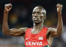 Ezekiel Kemboi of Kenya celebrates winning the men's 3000 metres steeplechase final during the15th IAAF World Championships at the National Stadium in Beijing, China August 24, 2015.  REUTERS/Lucy Nicholson
