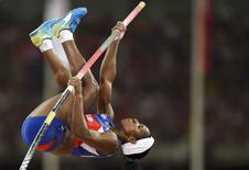 Yarisley Silva of Cuba competes in the women's pole vault final during the 15th IAAF World Championships at the National Stadium in Beijing, China, August 26, 2015.  REUTERS/Dylan Martinez
