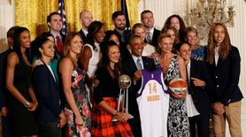 President Barack Obama poses with members of the Phoenix Mercury at a ceremony honoring the 2014 WNBA champion Mercury in the East Room at the White House. Mandatory Credit: Geoff Burke-USA TODAY Sports