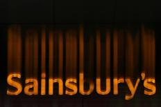 A Sainsbury's supermarket sign is seen in London January 6, 2015. REUTERS/Stefan Wermuth