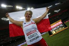 First placed Anita Wlodarczyk of Poland celebrates with national flag after the women's hammer throw final at the 15th IAAF World Championships at the National Stadium in Beijing, China, August 27, 2015.    REUTERS/Kai Pfaffenbach