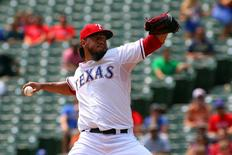 Aug 27, 2015; Arlington, TX, USA;  Texas Rangers starting pitcher Yovani Gallardo (49) pitches in the first inning against the Toronto Blue Jays at Globe Life Park in Arlington. Mandatory Credit: Ray Carlin-USA TODAY Sports