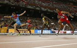 Sergey Shubenkov of Russia (L) crosses the finish line to win the men's 110m hurdles final during the 15th IAAF World Championships at the National Stadium in Beijing, China, August 28, 2015. REUTERS/Kai Pfaffenbach