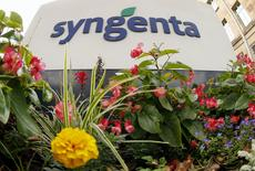 Flowers grow in front of Swiss agrochemicals maker Syngenta's logo at the company's headquarters in Basel August 19, 2015.  REUTERS/Arnd Wiegmann