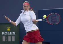 Toronto, Ontario, Canada; Petra Kvitova of the Czech Republic returns a ball to Victoria Azarenka of Belarus (not pictured) in their match during the second round of the Rogers Cup tennis tournament at Aviva Centre on Aug 12, 2015. Nick Turchiaro-USA TODAY Sports