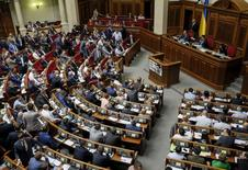 Members of parliament attend a session in Kiev, Ukraine, June 18, 2015. The parliament approved the decision of President Petro Poroshenko to dismiss the head of Ukraine's SBU security service Valentyn Nalivaichenko. The authorities did not announce the reason for his departure, but the SBU and other security services have been accused of failing to investigate crimes committed under previous president Viktor Yanukovich. REUTERS/Gleb Garanich