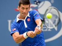 Aug 31, 2015; New York, NY, USA; Novak Djokovic of Serbia hits to Joao Souza of Brazil on day one of the 2015 US Open at USTA Billie Jean King National Tennis Center. Mandatory Credit: Robert Deutsch-USA TODAY Sports