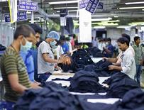 Employees work inside a garment factory of Orient Craft Ltd. at Gurgaon on the outskirts of New Delhi, India, July 3, 2015. REUTERS/Anindito Mukherjee