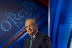 """Fox News Channel host Bill O'Reilly poses on the set of his show """"The O'Reilly Factor"""" in New York March 17, 2015. REUTERS/Brendan McDermid"""