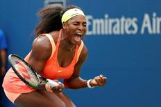 Sep 2, 2015; New York, NY, USA; Serena Williams of the United States reacts after winning the first set against Kiki Bertens of the Netherlands (not pictured) on day three of the 2015 U.S. Open tennis tournament at USTA Billie Jean King National Tennis Center. Williams won 7-6 (5), 6-3. Mandatory Credit: Geoff Burke-USA TODAY Sports