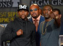 Aug 6, 2015; Los Angeles, CA, USA; Mayweather Promotions CEO Leonard Ellerbe looks on as Floyd Mayweather, Jr. and Andre Berto face off during a press conference to announce the upcoming fight on September 12, 2015 at J.W. Marriott LA Live. Mandatory Credit: Jayne Kamin-Oncea-USA TODAY Sports