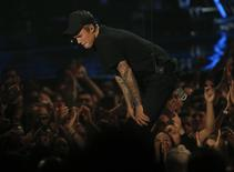 Justin Bieber reacts as he finishes performing a medley of songs at the 2015 MTV Video Music Awards in Los Angeles, California August 30, 2015.  REUTERS/Mario Anzuoni
