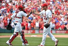 Sep 9, 2015; St. Louis, MO, USA; St. Louis Cardinals catcher Yadier Molina (4) and St. Louis Cardinals relief pitcher Trevor Rosenthal (44) celebrate defeating the Chicago Cubs 4-3 at Busch Stadium. Mandatory Credit: Jasen Vinlove-USA TODAY Sports