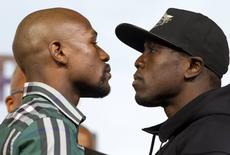 Undefeated WBC/WBA welterweight champion Floyd Mayweather Jr. (L) faces off with challenger Andre Berto during a news conference at MGM Grand Hotel & Casino in Las Vegas September 9, 2015. REUTERS/Las VegasSun/Steve Marcus