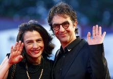 """Director Atom Egoyan and his wife Arsinee Khanjian attends the red carpet event for the movie """"Remember"""" at the 72nd Venice Film Festival, northern Italy September 10, 2015. REUTERS/Stefano Rellandini"""