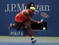 Serena Williams of the U.S. runs to chase down a return from Roberta Vinci of Italy in the third set during their women's singles semi-final match at the U.S. Open Championships tennis tournament in New York, September 11, 2015. REUTERS/Mike Segar  Picture Supplied by Action Images