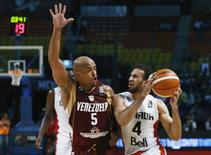 Canada's Philip Scrubb (4) controls the ball against Venezuela's Gregory Vargas (5) during their 2015 FIBA Americas Championship semi-final basketball game, at the Sports Palace in Mexico City September 11, 2015. REUTERS/Henry Romero