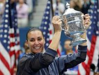 Flavia Pennetta of Italy holds the U.S. Open Trophy after defeating compatriot Roberta Vinci in their women's singles final match at the U.S. Open Championships tennis tournament in New York, September 12, 2015.    REUTERS/Mike Segar