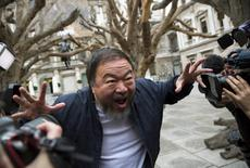 Chinese artist Ai Weiwei poses for photographers during a photocall for his exhibition at the Royal Academy of Arts in London, Britain September 15, 2015. REUTERS/Neil Hall