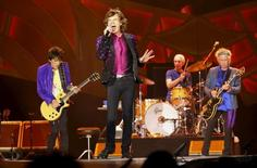 """British veteran rockers The Rolling Stones singer Mick Jagger sings next to band member Keith Richards, Ronnie Wood and Charlie Watts as they open their North American """"Zip Code"""" tour in San Diego, California May 24, 2015.     REUTERS/Mike Blake     - RTX1EEZE"""