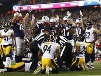 Sep 10, 2015; Foxborough, MA, USA; The New England Patriots celebrate a touchdown against the Pittsburgh Steelers during the second half at Gillette Stadium. Mandatory Credit: Mark L. Baer-USA TODAY Sports
