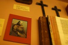 A holy card with the image of Friar Junipero Serra is shown at Mission San Diego de Alcala in San Diego, California, September 14, 2015. REUTERS/Mike Blake