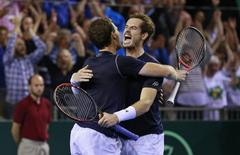 Tennis - Great Britain v Australia - Davis Cup Semi Final - Emirates Arena, Glasgow, Scotland - 19/9/15 Men's Doubles - Great Britain's Andy Murray celebrates with Jamie Murray after winning their match Action Images via Reuters / Jason Cairnduff Livepic